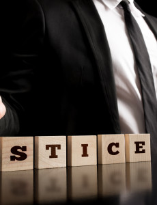 Justice on Wooden Piece Arranged by Businessman